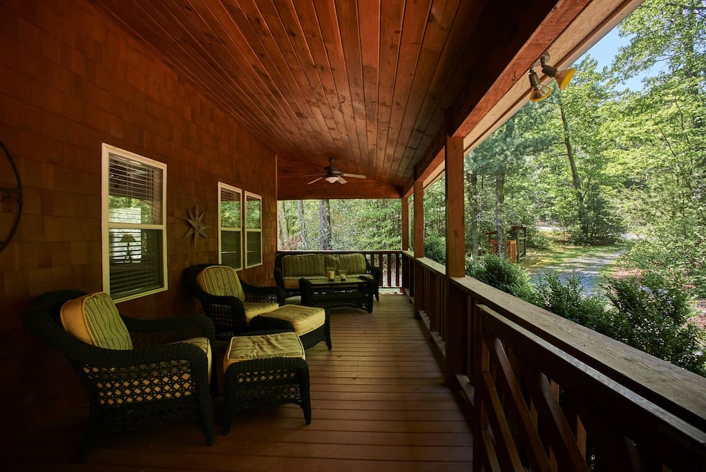 Huge covered front porch with comfy porch furniture