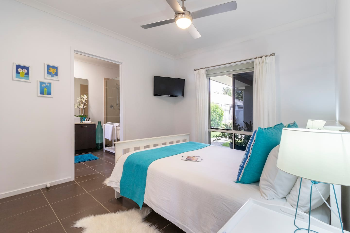 The light and airy double bedroom leads into a large, private en-suite  bathroom. The room has a wall mounted TV for your viewing pleasure.