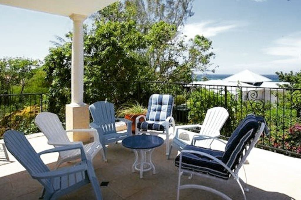 Spacious & scenic upstairs patio. Accessible via master bedroom and pool deck