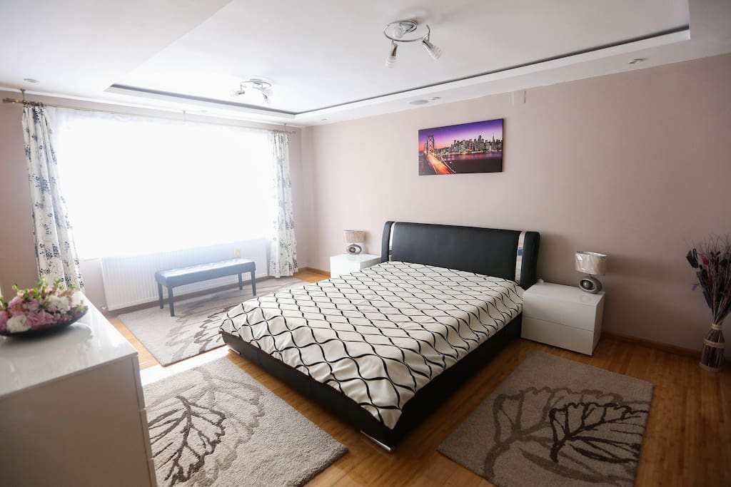Main bedroom with king bed, private bathroom and dressing.