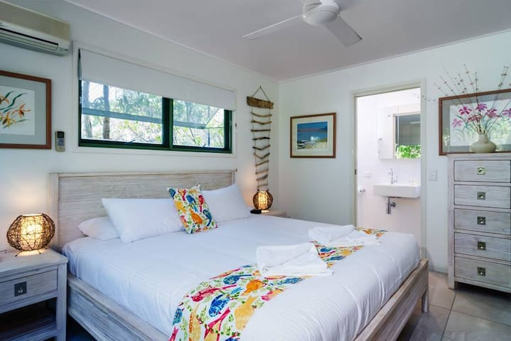 Main bedroom with ensuite in one of the Beach Houses.