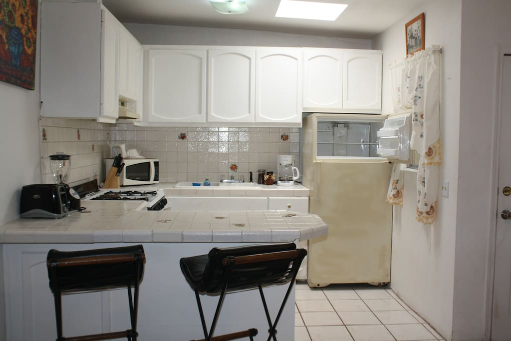 You well find this fully loaded Kitchen with microwave, toaster,  blender and coffee maker with coffee, cream and suger.