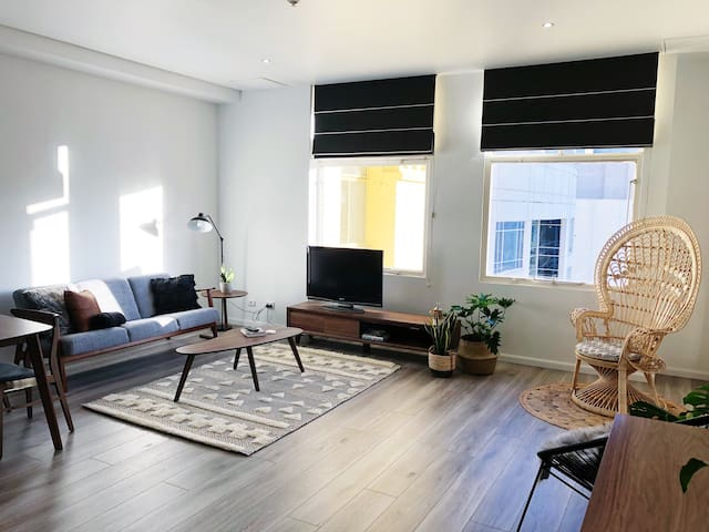 Bright and spacious living room. Be sure to try our peacock chair and take a snap or two. You can even tag us @melbournegems to share your experience