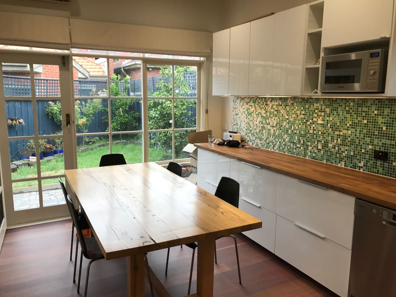 Kitchen with amazing light and access to back yard