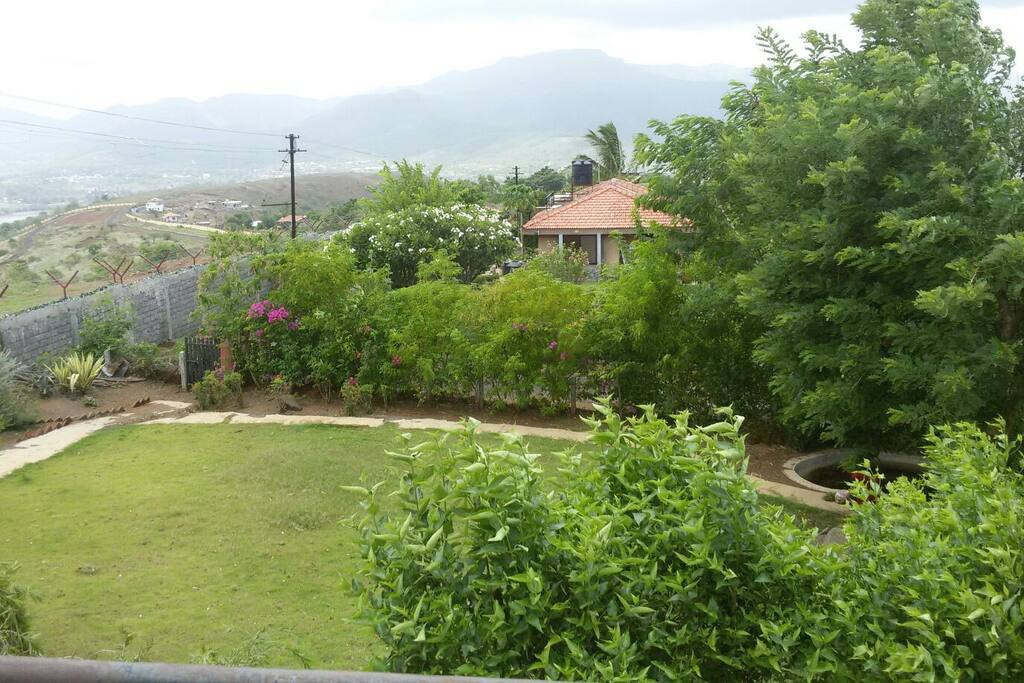 Front lawn. The magnificent Sinhagad fort is the high plateau in the background !
