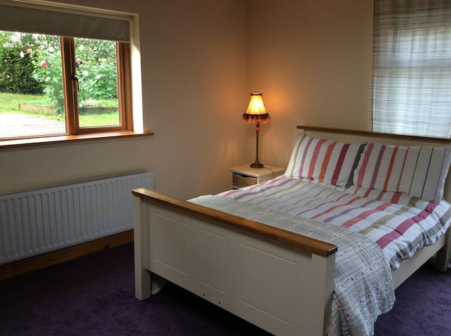 Double bed at Angler's Lodge