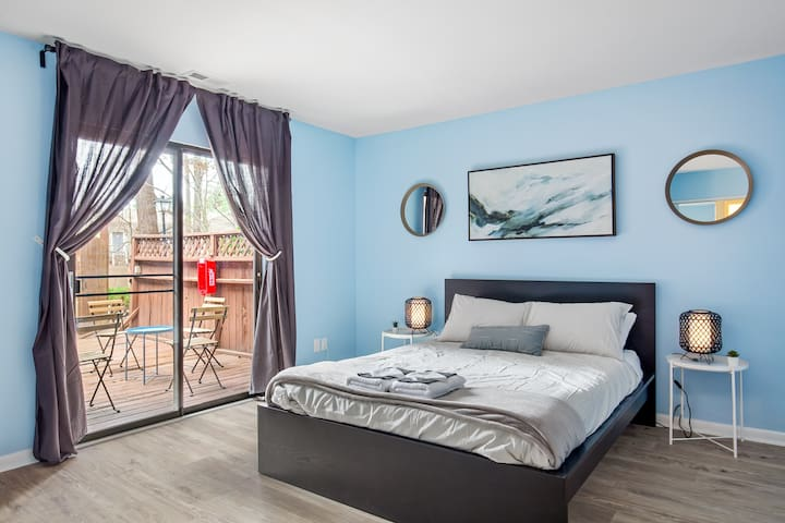 Master Bedroom features a queen bed with foam mattress and has access to the patio area.