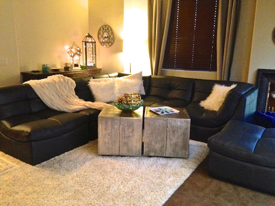 Cozy living room! You will love snuggling up on this sofa for a movie night with your family