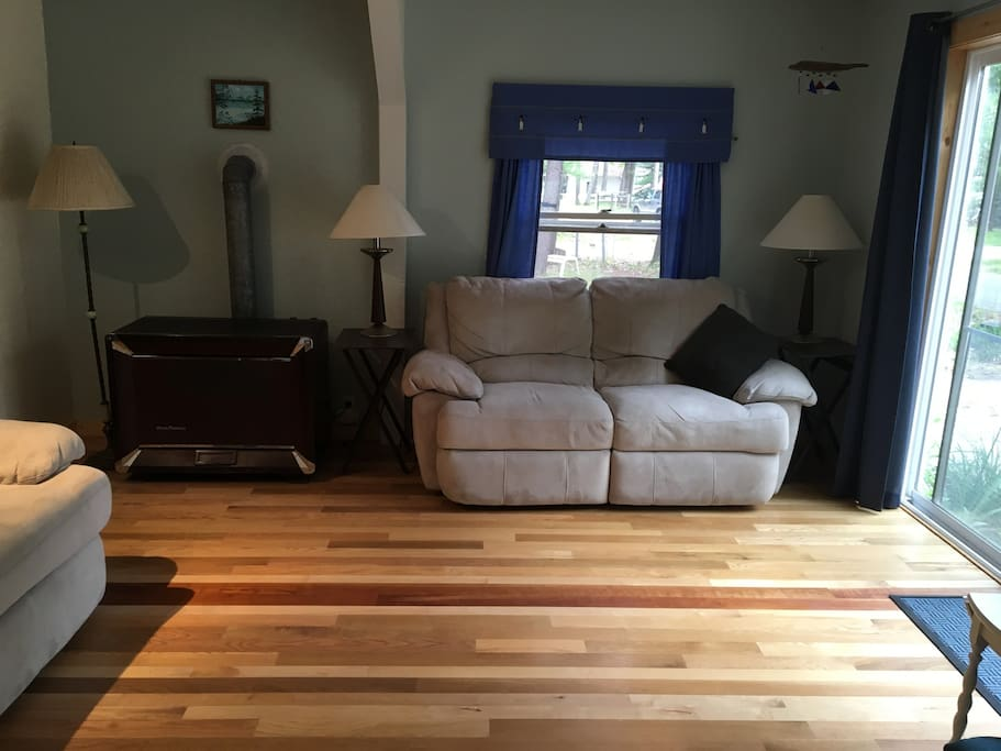 Love seat by the slider, beautiful hardwood floor