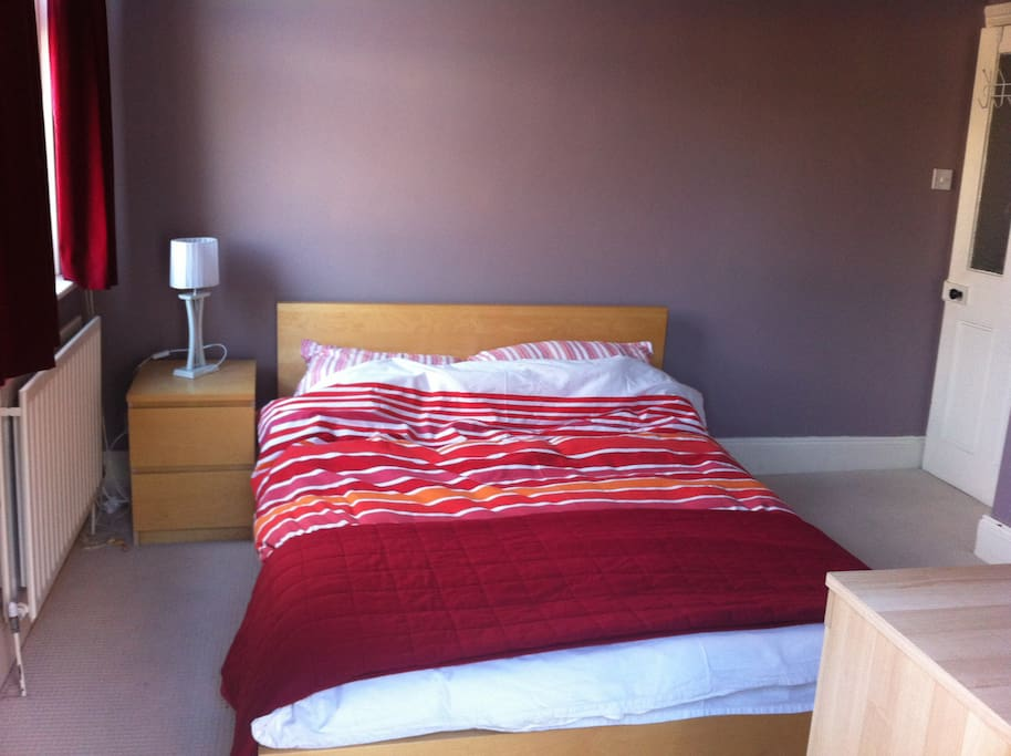 Double bed, bedside table, lamp