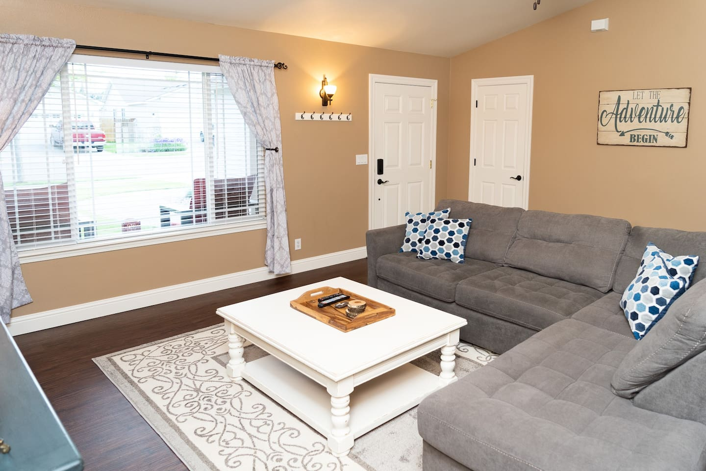 Cozy living area with a plush sectional sofa, 65 inch TV, Blu-Ray & DVD Movies, etc.