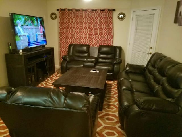 "Living room with 65""Tv plus cable - Austell - Apartmen"