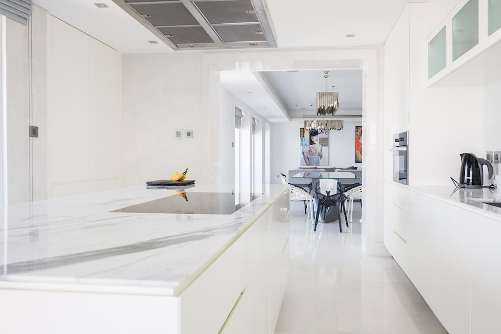 All white marble full kitchen with balcony with  great light from the Arabian Sea overlooking the famous Palm Jumeriah.