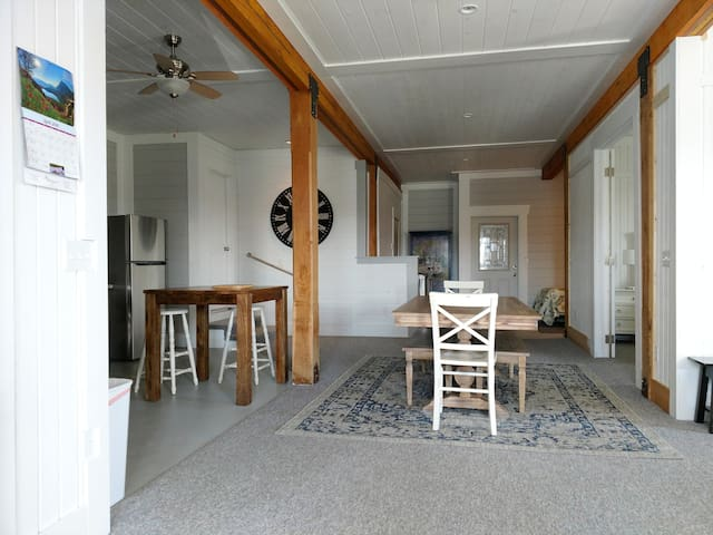 Entry into Open Living area with Large Dining Table
