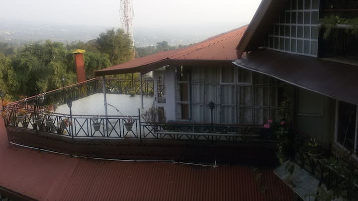 nandini homestay mountain view Glass facade cabin