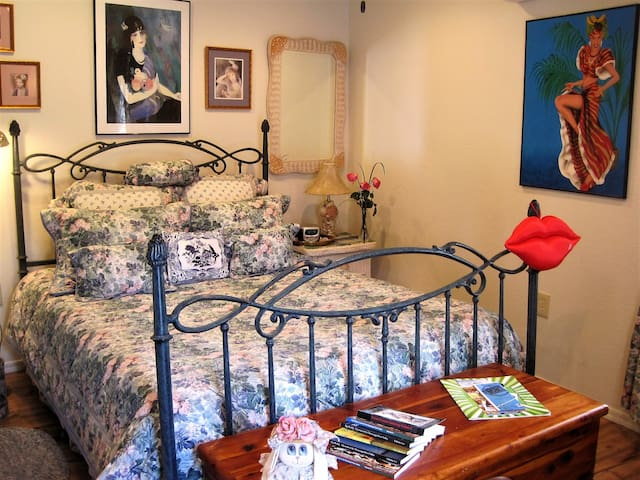 The casita is filled with lots of art from the hosts' collection. And that bed? Ahhh, perfect for naps after a day of browsing downtown