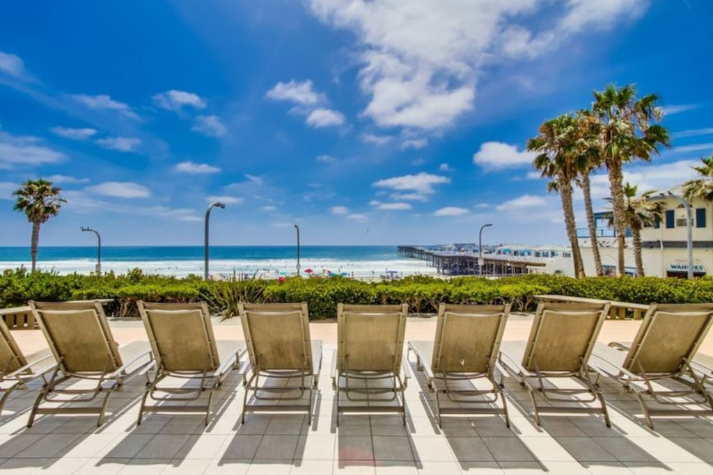 View of boardwalk and ocean from condos` shared patio area.