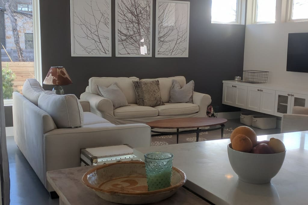 Open living/dining area. That's a sleeper sofa against the gray wall.