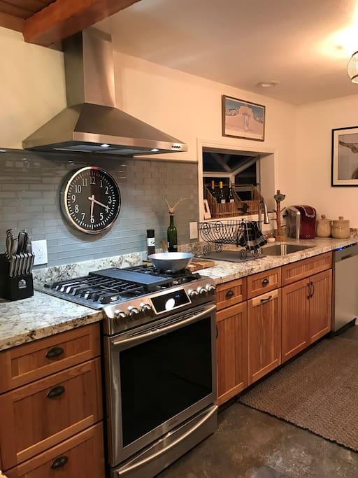 Modern kitchen gas stove, dishwasher, refrigerator, microwave