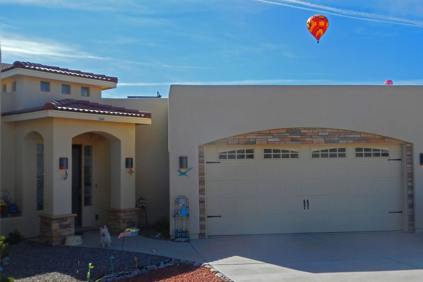 At times when the wind is right, hot air balloons appear over my house