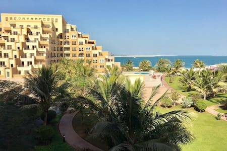 Cozy 1BR apt with sea and pool view - RAK