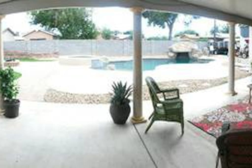 Relax on the back deck and with views of the pool hot tub and fire pit!