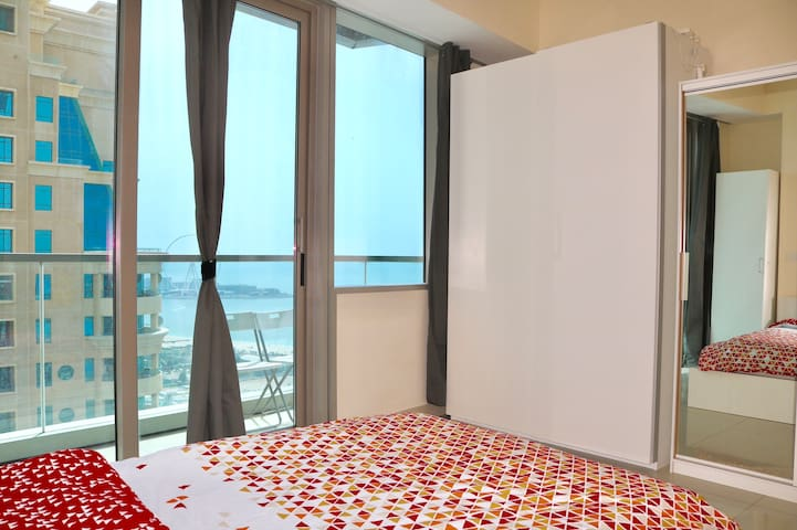 Bedroom with attached balcony and wardrobes