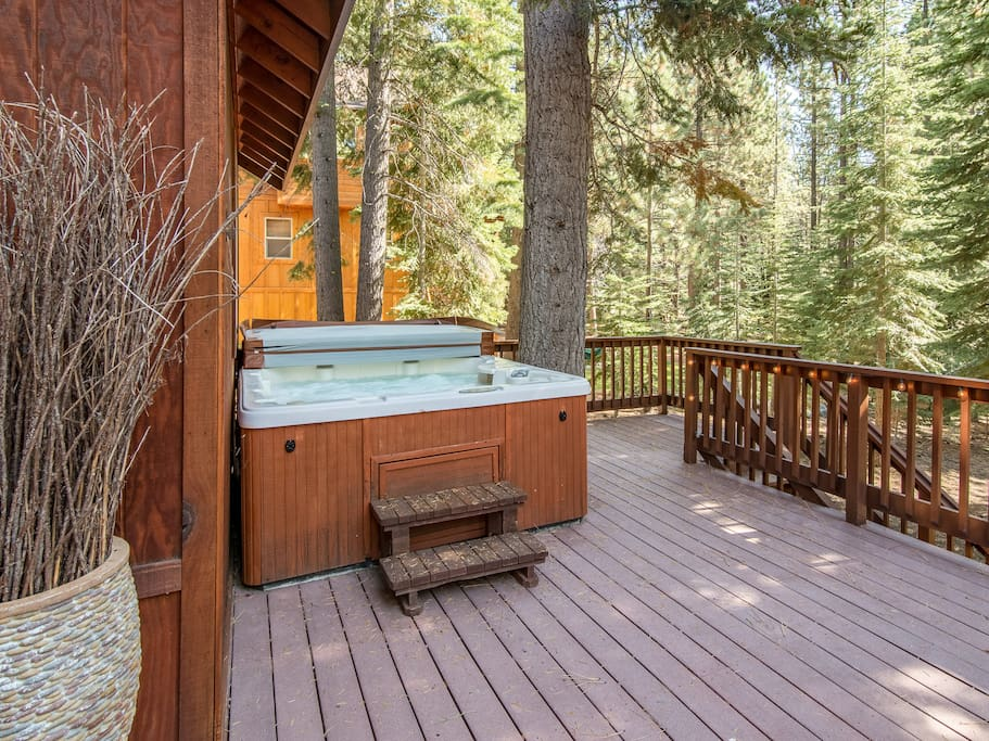 The private hot tub invites relaxation on the deck.
