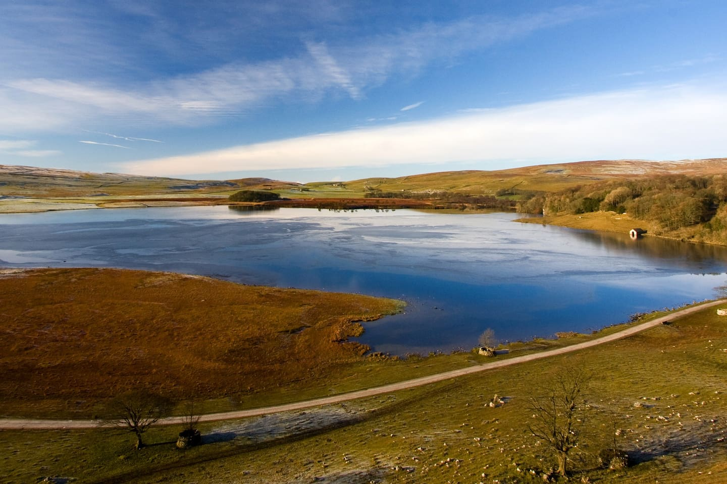 View of Malham Tarn, field centre is in the woods to the right