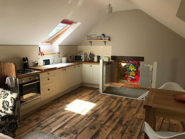 Open plan kitchen with oven, hob, dishwasher, fridge (with freezer compartment) and full cooking facilities. Complimentary tea, coffee, sugar, milk and maybe an egg or two from our hens!