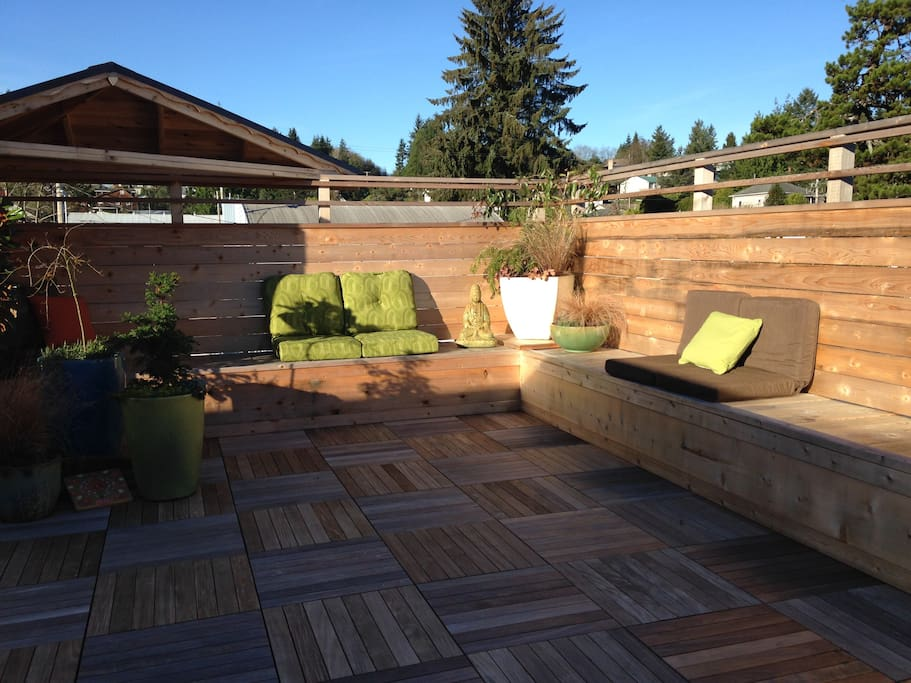 Rooftop deck seating and Yoga space