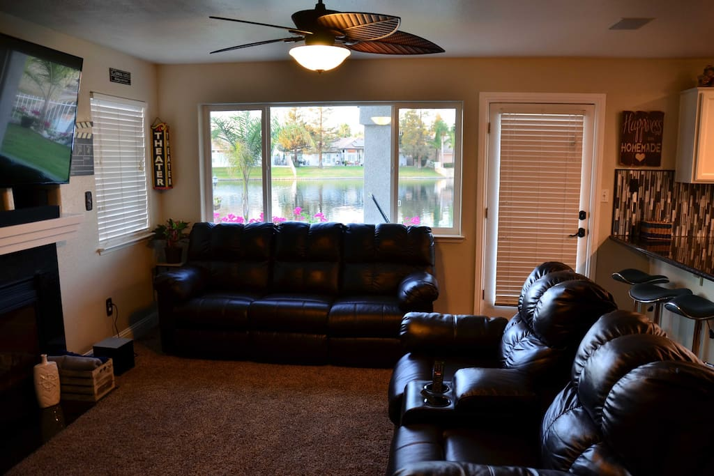 """Family room with 65"""" HDTV."""