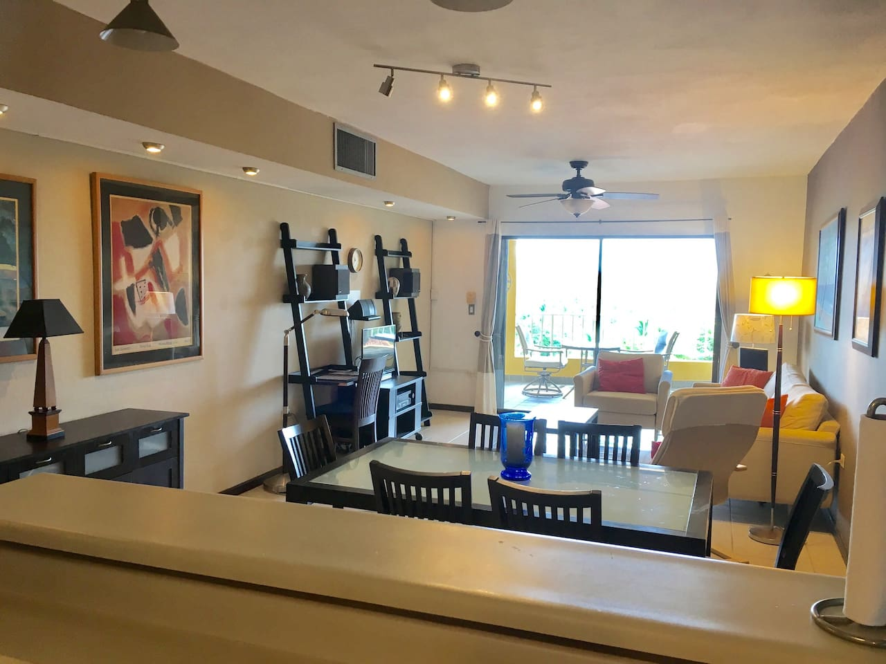 Dining and living room has a sliding door with access to the balcony.