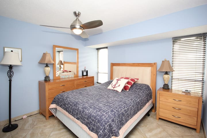 Second room: Spacious room with Queen bed.