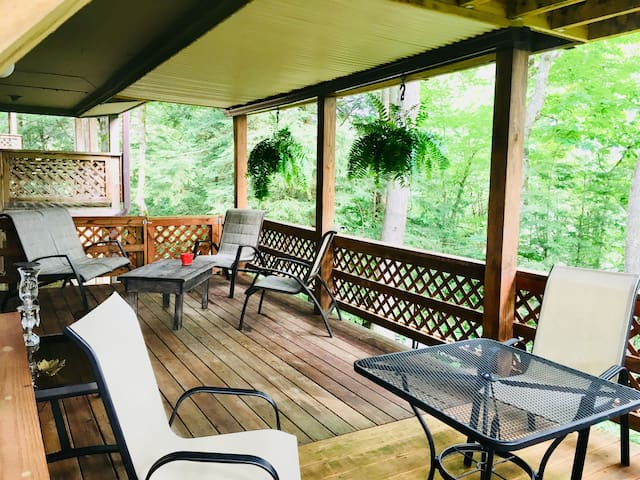 You will enjoy this huge deck surrounded by trees.