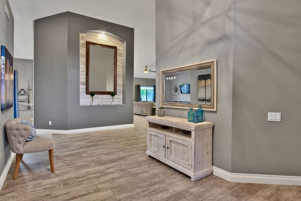 You are sure to feel welcome as you enter our home, the foyer is framed by high ceilings and supremely welcoming.