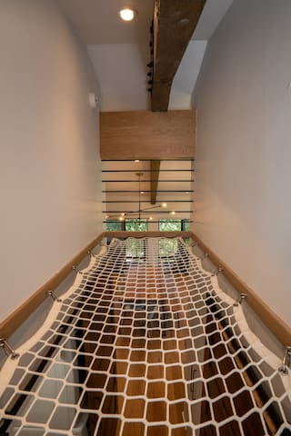 Climb on out to the Cargo Net Hammock over the hallway - rated for 250 lbs
