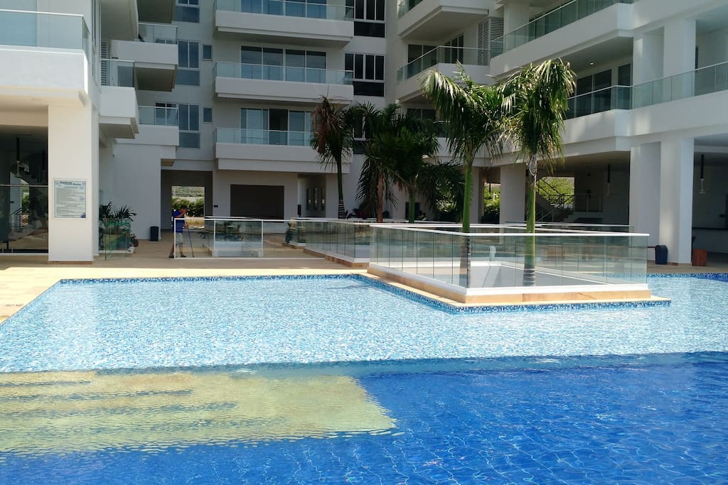 Swimming pool with 3 internal hot tubs, kids area and fountains.