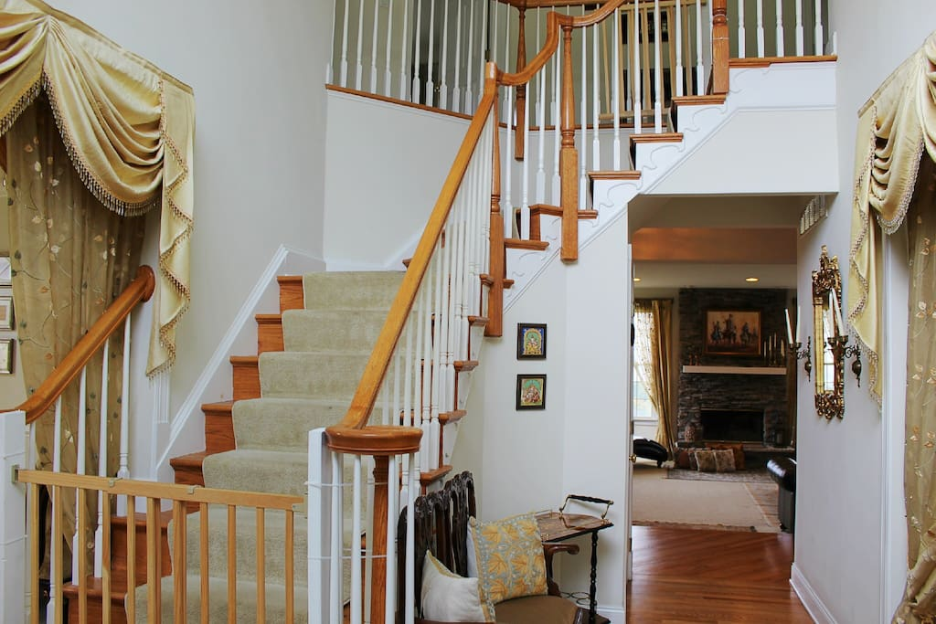 Entry foyer with baby gates on stairs!