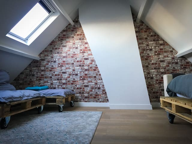 2nd floor, attic room. Not bad for a teenagers room eh? With home made bed & couch. On wheels :))