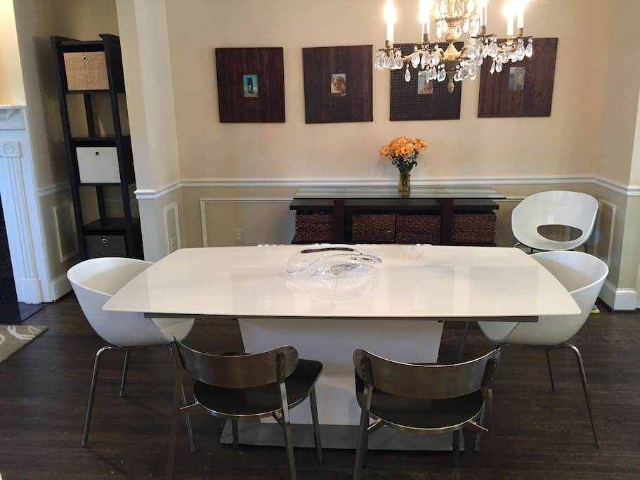 The dining room table can expand to fit 10+ comfortably.