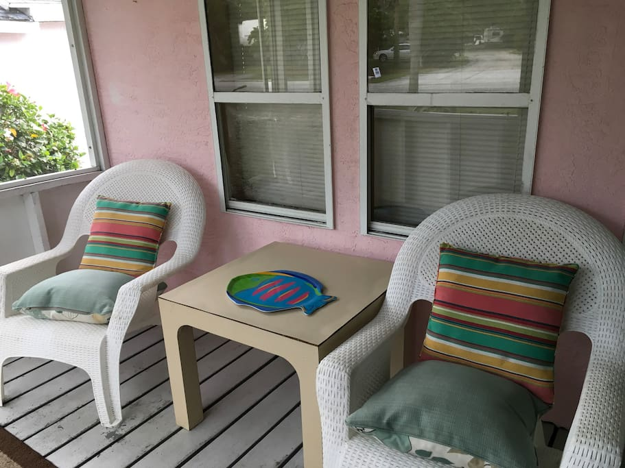 Guests enjoy the screened in porch.