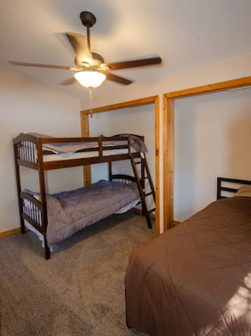 Upstairs bedroom #3 with one bunk bed and one full bed