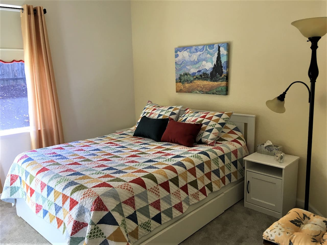 New firm but  soft queen bed,  Van Gogh art, colorful quilt.  Drawers under bed and in closet.