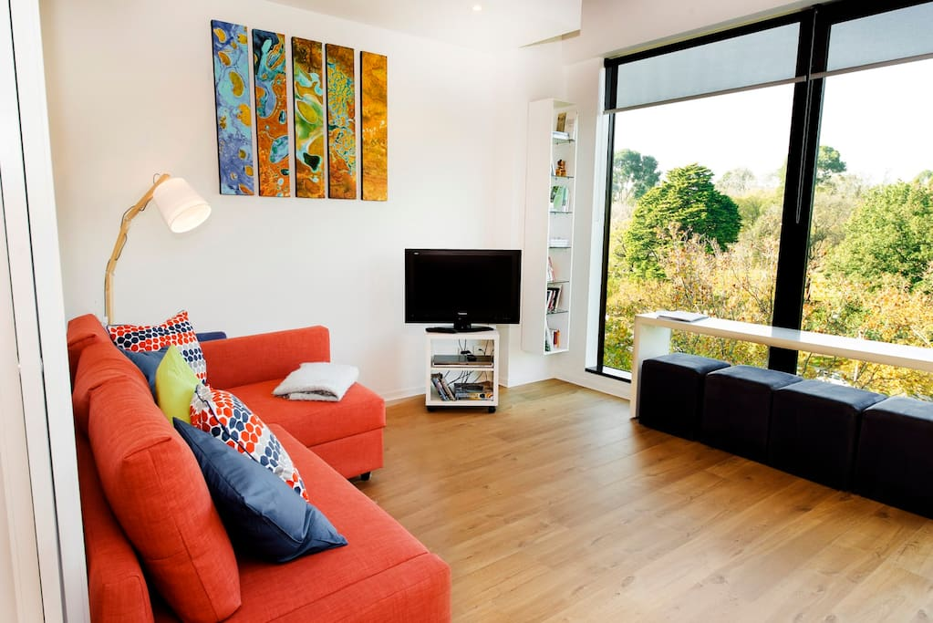 The lounge room is spacious and comfortable.  Enjoy the view while you relax on the couch or watch TV or a DVD