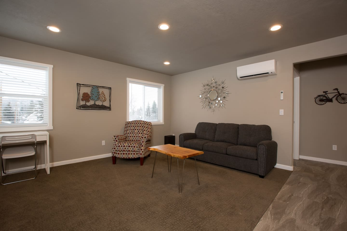 Living room with reclining chair and comfortable couch/hide-a-bed with memory foam mattress