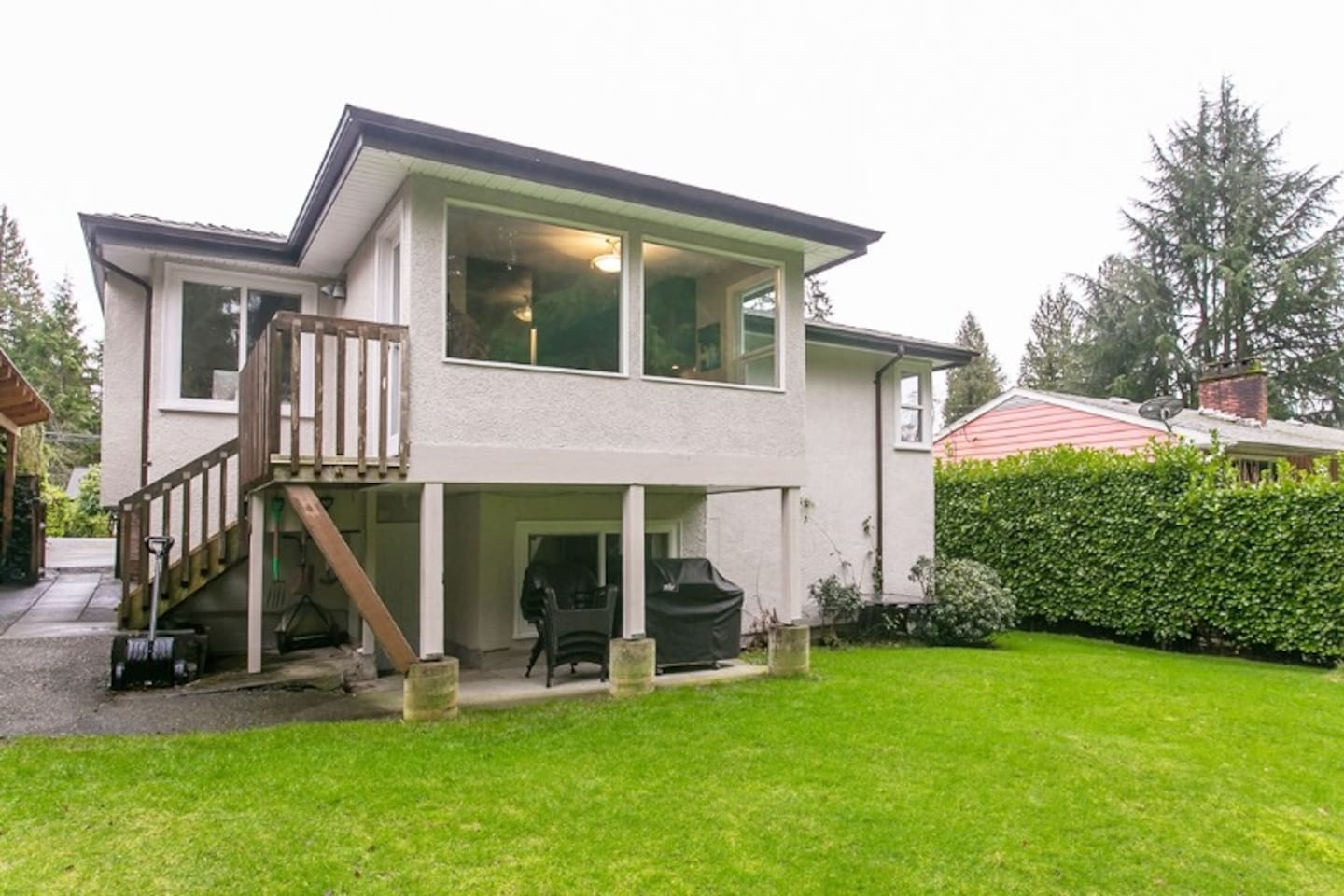 Family home with private suite and large  tranquil shared back yard with hot tub and BBQ