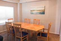 Dining Room Table. Extra Chairs in Closet
