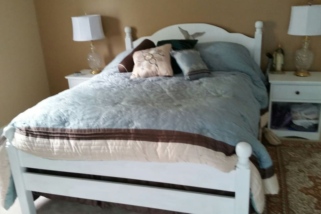 master bedroom with delux pillow top mattress