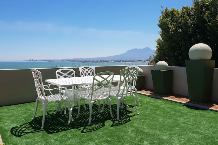 Balcony with gas bbq, comfortable seating and fantastic views